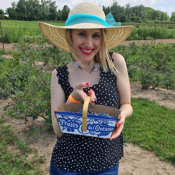 Girl Holding Blueberry basket